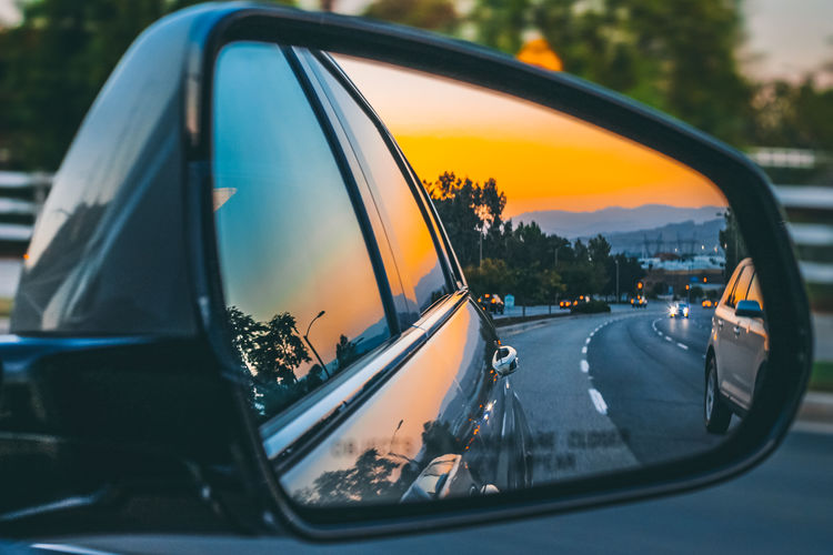 Orange Skies Car City Close-up Glass - Material Land Vehicle Mirror Mode Of Transportation Motion Motor Vehicle Nature No People Orange Color Outdoors Reflection Road Road Trip Side-view Mirror Sky Sunset Transportation Vehicle Interior Vehicle Mirror A New Beginning