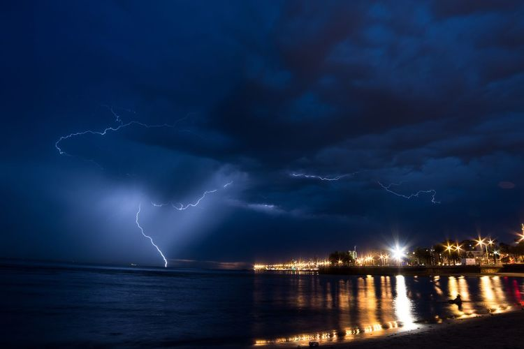 Night Lightning Thunderstorm Storm Water Sea Power In Nature Forked Lightning Nature No People Sky Cityscape Horizon Over Water Outdoors
