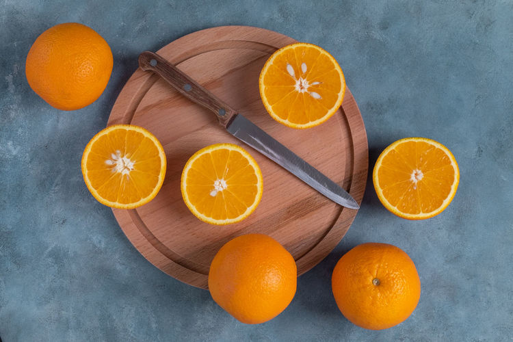 High angle view of orange fruits on cutting board
