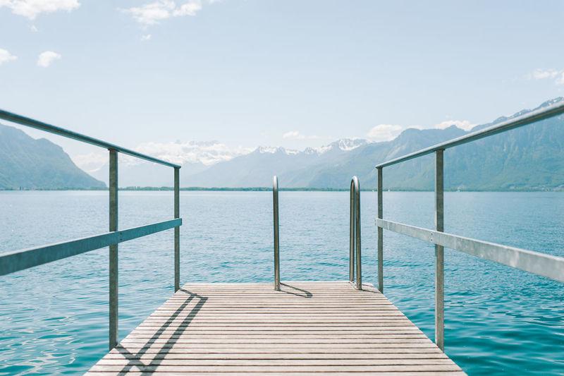 Pier on sea against clear sky
