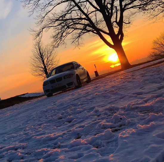 Sunrise Sunset Transportation Mode Of Transport Sky Nature Land Vehicle Scenics No People Beauty In Nature Winter Cold Temperature Car Sun Snow Outdoors Tree Day