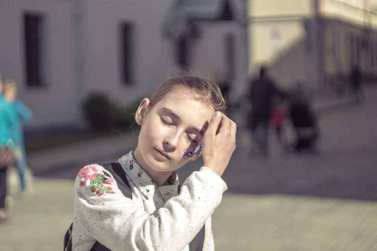 Close-Up Of Girl On Street