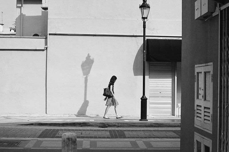 Analogue Photography Black And White Filmisnotdead 35mm Film B&w Street Photography Film Photography Singapore Recommended Photographers January City Urban Strideby The Street Photographer - 2016 EyeEm Awards One Person Carrying A Purse Lampost Light And Shadow Shadows On The Wall Alone Lonely Woman Walking People Walking Past Walls Kampong Glam Street Scene Fine Art Photography