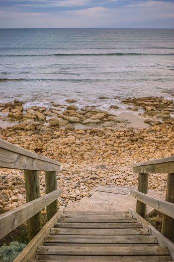 Steps Stairs Wooden Texture Wooden Panels Railing Sea Water Beach Scenics Railing Wood - Material Nature Tranquil Scene Sand Vacations No People Tranquility Sky Outdoors Day Architecture
