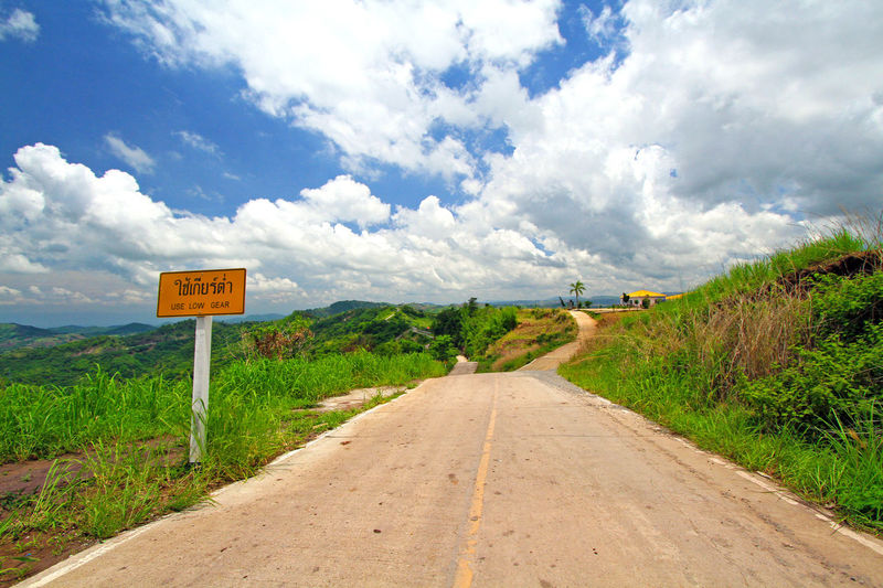 Cloud - Sky Sky The Way Forward Outdoors Day Road Road Sign No People Scenics Nature Grass Hills Park Traveling View Lines And Shapes Pathway Transportation Trip Drive Notice Slope Landscape Rural Nature