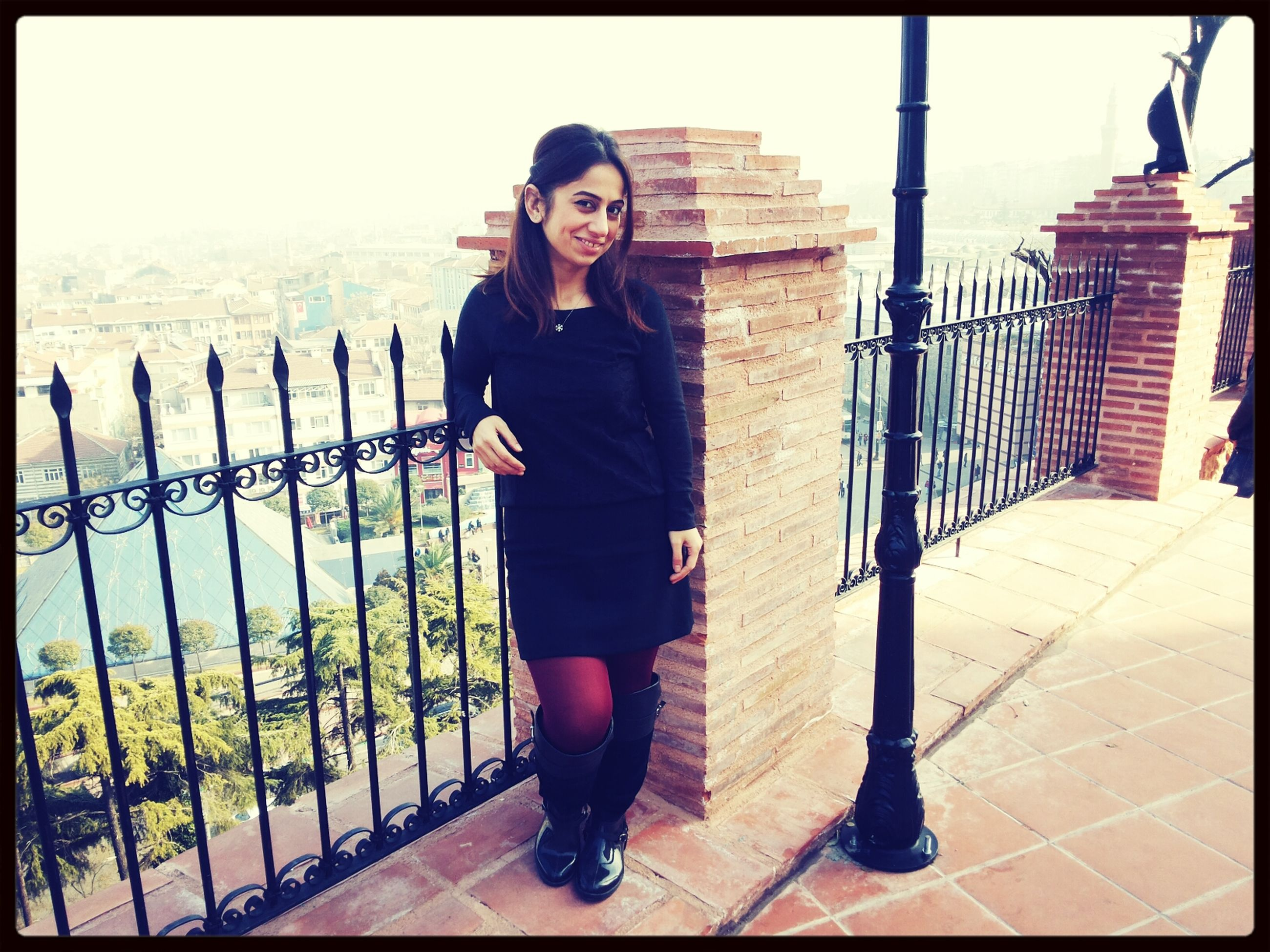 transfer print, full length, young adult, lifestyles, casual clothing, standing, leisure activity, front view, young women, person, auto post production filter, looking at camera, portrait, railing, three quarter length, built structure, architecture