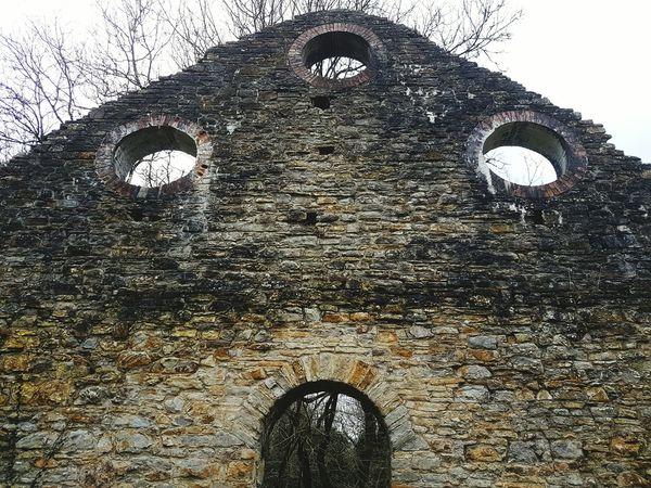 Hand cut stonework No People Textured  Day Outdoors Industry Industrial Historical Historic History Welsh Iron Works Ironworks Ironwork  Iron Architecture Arch Windows Three Circular Window Stonework
