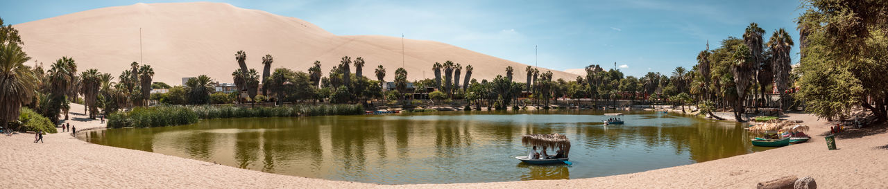 Finally we arrived at the dunes in Huacachina. Outdoors Nature Travel Destinations Mountain Range Mountain Moody Explore Discover  Adventure Idyllic Tranquility Tranquil Scene Panorama Sky Day Oasis Desert Water Lake Boat Real People Incidental People Palm Tree Dunes Sand