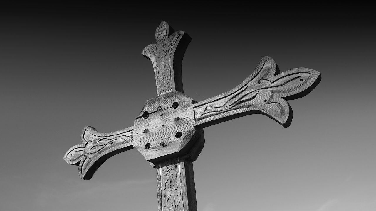 low angle view, sculpture, no people, cross, religion, spirituality, statue, day, clear sky, sky, outdoors
