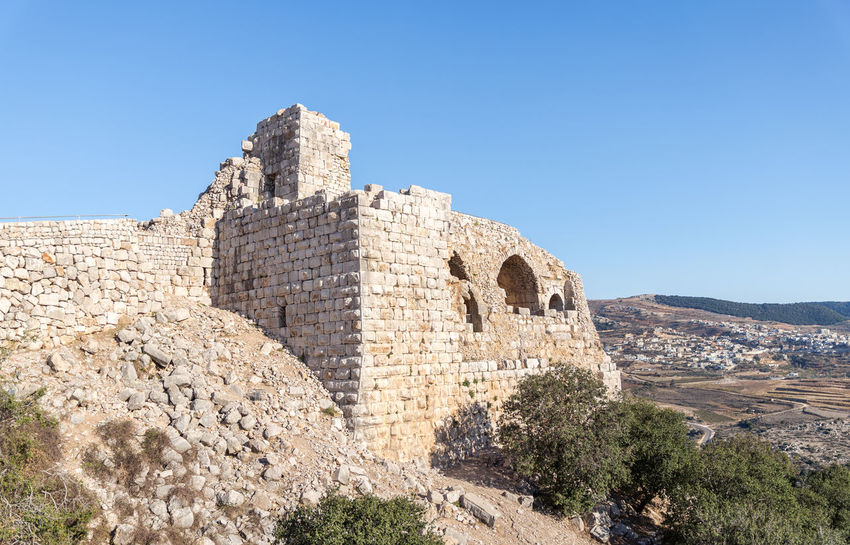 The destroyed corner tower of Nimrod Fortress located in Upper Galilee in northern Israel on the border with Lebanon. Israel Nimrod Fortress History Heritage Castle Fort Saladin Beybars Crusaders Ayubids Mamluks Assassins Tower Travel Destinations Tourism Old National Park Hill Stone Material Wall Ancient Architecture Medieval Architecture Protection Ruin Galilee