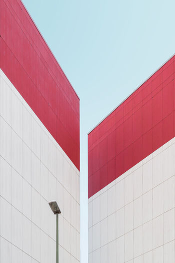 Negative Space Architecture Asymmetry Building Exterior Built Structure Clear Sky Concrete Geometric Shape Low Angle View Minimalism No People Outdoors Pastel Power Red Symmetry Urban Geometry Minimalist Architecture