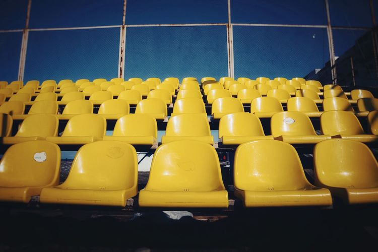 Yellow Minimal Yellow Pattern In A Row Side By Side Seat Empty Sport Yellow Large Group Of Objects No People Chair Repetition Architecture Day Outdoors Stadium