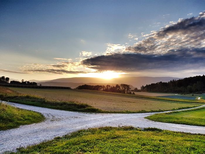 Field Scenics Agriculture Sunset Landscape Rural Scene Sky Beauty In Nature Nature No People Multi Colored Cloud - Sky Grass Outdoors