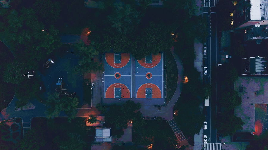 Aerial view of basketball court by road