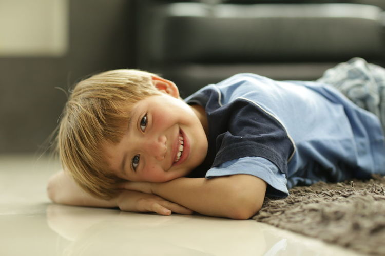 Blond Hair Child Childhood Children Only Close-up Day Digital Native Happiness Headshot Indoors  Looking At Camera Lying Down One Person People Portrait Smiling Technology