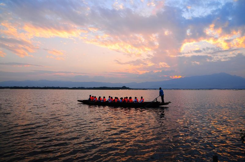 Boat Mode Of Transport River View Water Transportation Lifestyles Real People Sunset Outdoors Sampn Travel Lagoon Water