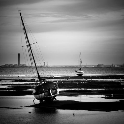 Black And White Boat Boats Chimneys Day Estuary Horizon Over Water Industrial Chiq Kent Leigh On Sea Low Tide Mast Mud Flats Outdoors Paula Puncher Sailboat Sailing Scenics Sea Sky Thames River Tide Out Tranquil Scene Water Weather