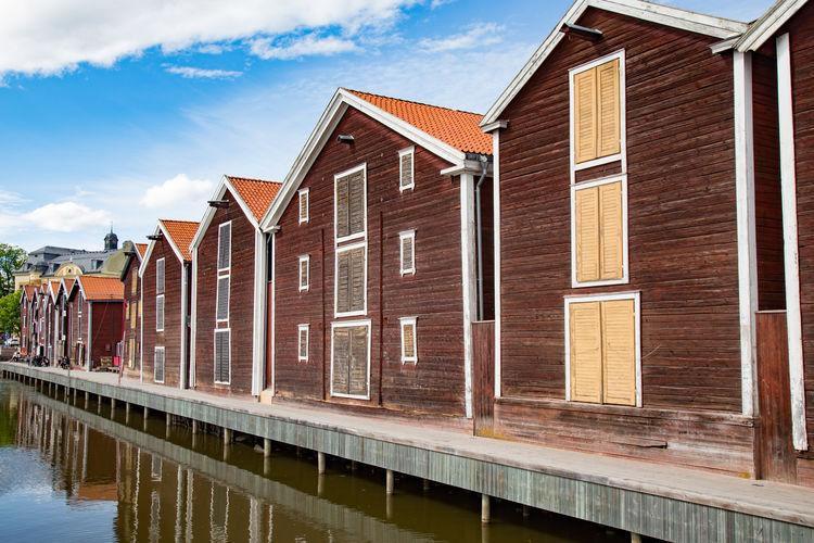 Houses against sky in city