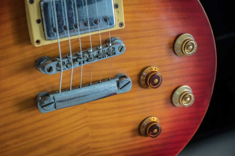 orange electric guitar close up on dark background Amp Amplifier Background Band Beautiful Black Blues Closeup Concert Distortion Electric Electronic Elegant Entertainment Equipment Fret Funk Guitar Instrument Jazz Melody Metal Music Musical Musician Overdrive Play Polish Power Rock Rosewood Sound String Stringed Sunburst Tone Vintage Volume White Wooden String Instrument Arts Culture And Entertainment Musical Instrument String Musical Equipment No People Close-up High Angle View Table Musical Instrument Studio Shot