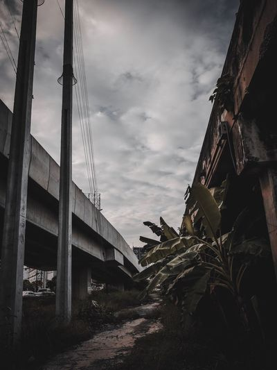 Low angle view of abandoned building against sky