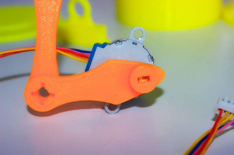 3D Printed Electronics  Focus On Foreground Mechanical Art Mechanical Engineering Mechanical Things Moving Parts Orange Color Stepper Motor Technology Yellow Color Close Up Technology