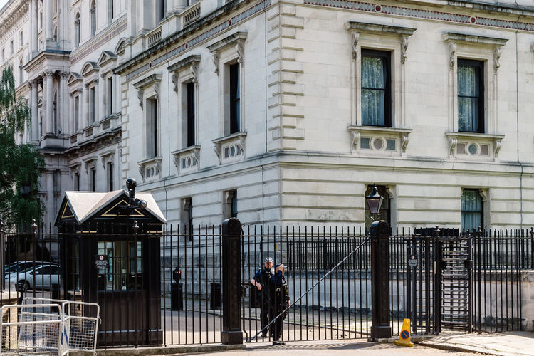 Police officers guarding 10 Downing Street back entrance gate in the City of Westminster, London, UK. 10 of Downing Street is the residence of the Prime Minister of the United Kingdom 10 Downing Street Brexit Britain London Primer Minister Theresa May Uk Architecture Attraction British Building Capital City Cityscape Conservative Control Crisis Downing Downing Street Election England English European  Famous Gate Government House KINGDOM Landmark Leader Minister Palace Parliament Police Political Politician Politics Power Prime Prime Minister Protection Residence Safety Security Street Terror Terrorism Travel Westminster Whitehall Real People