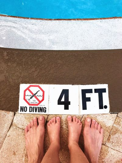 Dramatic Angles photo 1 of 3. Week 1 of 10 assignment. Kris Slater Father & Son Poolside Pool No Diving 4ft Above Shooting Down Water Sunlight Swimming Blue Water Personal Perspective Outdoors In Front Of Close-up Message EyeEm Iphone7photo