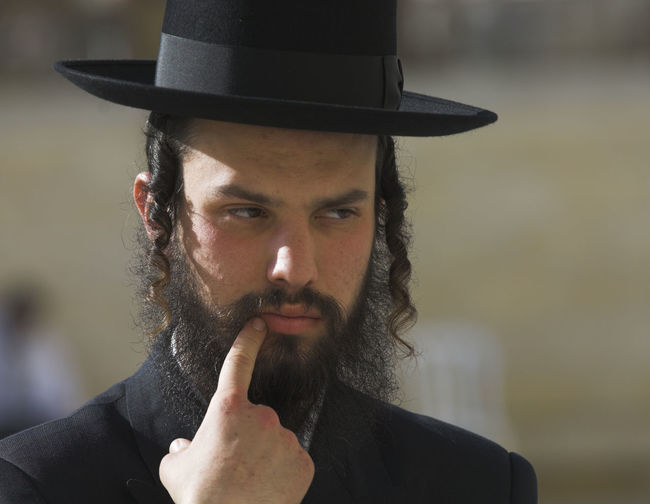 Close-up of rabbi wearing hat