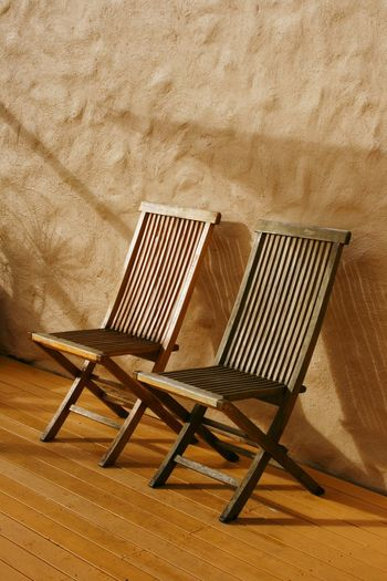 A quiet spot to relax on the patio Abstract Photography Brown Color Chair Close-up Day Folding Chairs Furniture Hardwood Floor Indoors  No People Old-fashioned Pair Two Of A Kind Wood - Material Wooden Chairs