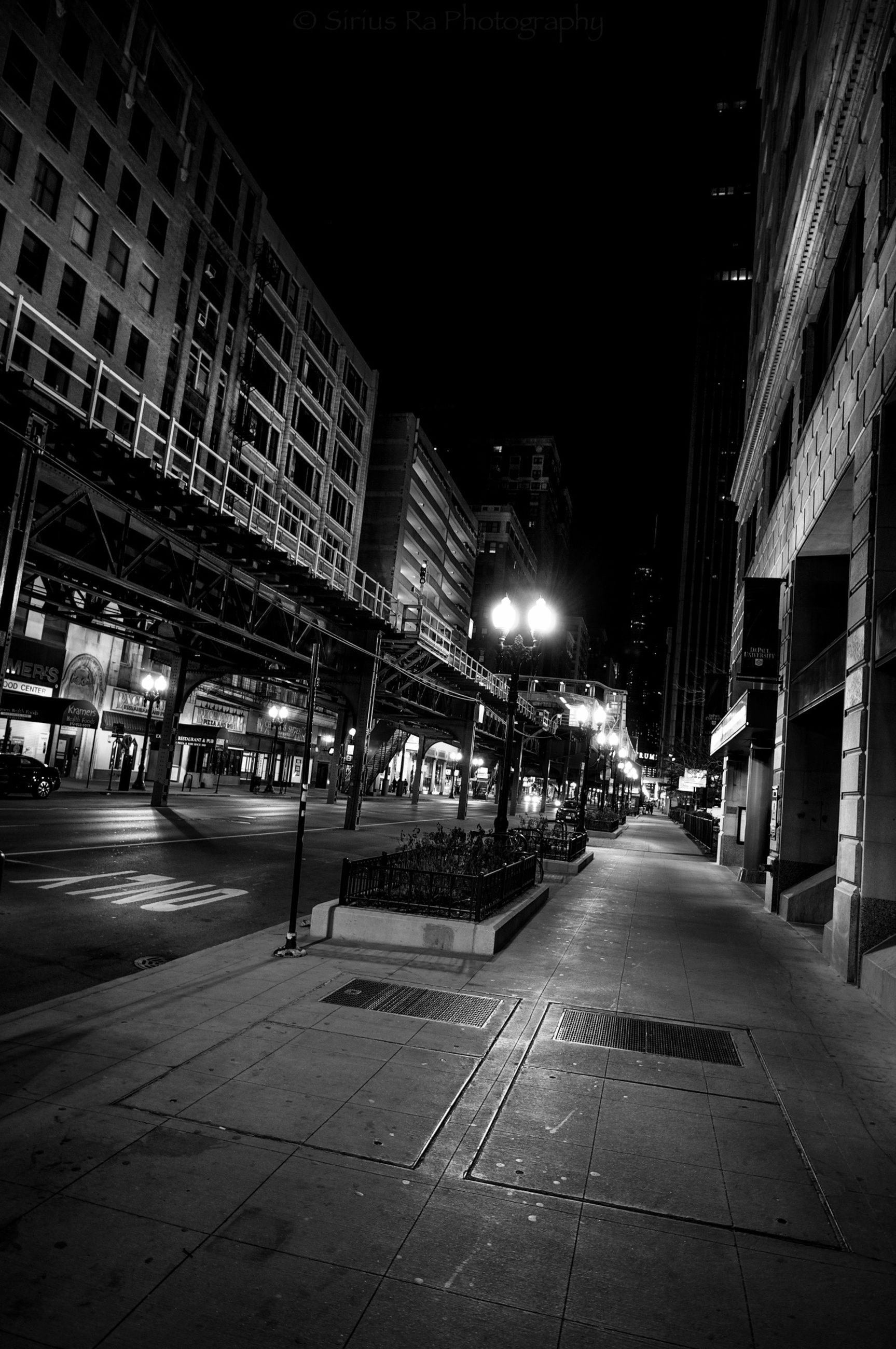 night, building exterior, architecture, built structure, illuminated, street, city, the way forward, transportation, road, street light, city life, city street, road marking, building, diminishing perspective, vanishing point, lighting equipment, outdoors, car