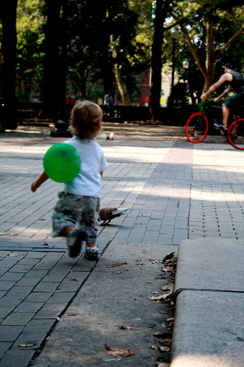 Rittenhouse Square Balloon Bicycle Boys Child Childhood City Men Outdoors Pig Real People Transportation Wheelie