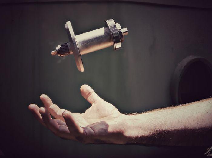 Cropped hand catching machine part