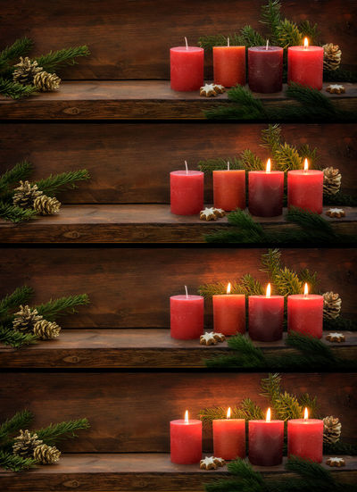Close-up of burning candles in row