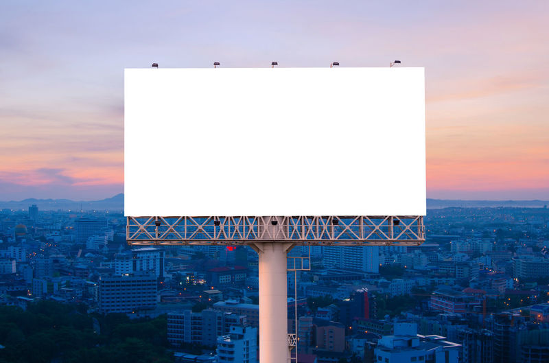 Architecture Built Structure Building Exterior Billboard Blank Sky City Nature Copy Space No People Communication Outdoors Building Sign Advertisement Red Sunset Cloud - Sky Sport Cityscape Marketing