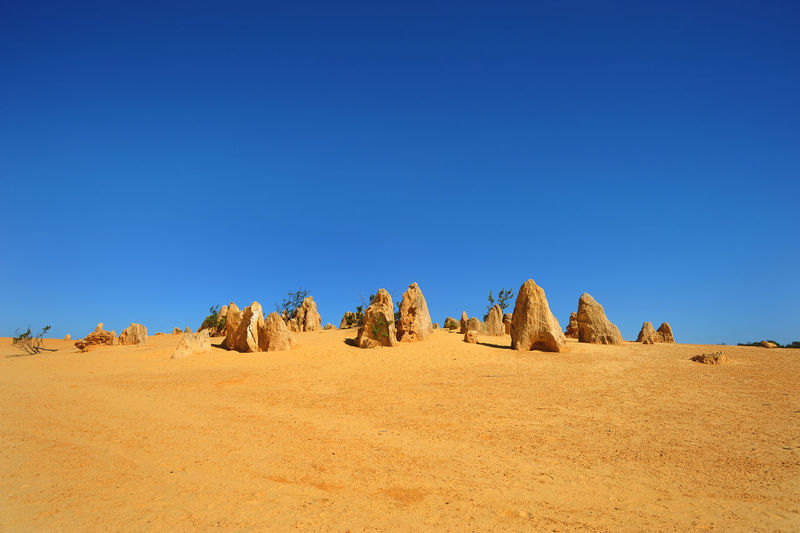 Rock formation against clear blue sky at the pinnacles