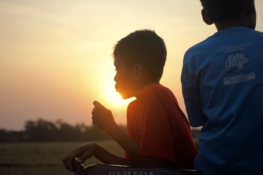 Before Sunset INDONESIA Sky And Clouds Boys Childhood Communication Day Jepara Leisure Activity Nature Outdoors People Real People Side View Sitting Sky Sunset Togetherness Two People