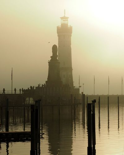 A foggy afternoon at the lake Bodensee Fog Germany Hafeneinfahrt Lake Lake View Lighthouse Lindau Löwendenkmal Port Travel Destinations Water Waterfront Wintertime Olympus OM-D EM-1
