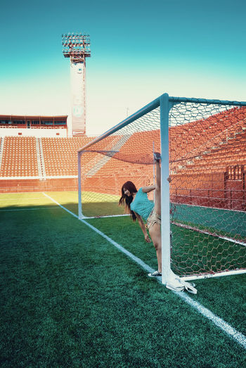 Built Structure Casual Clothing Day Grass Grassy Leisure Activity Outdoors Sky Soccer Stadium Sunlight Sunny