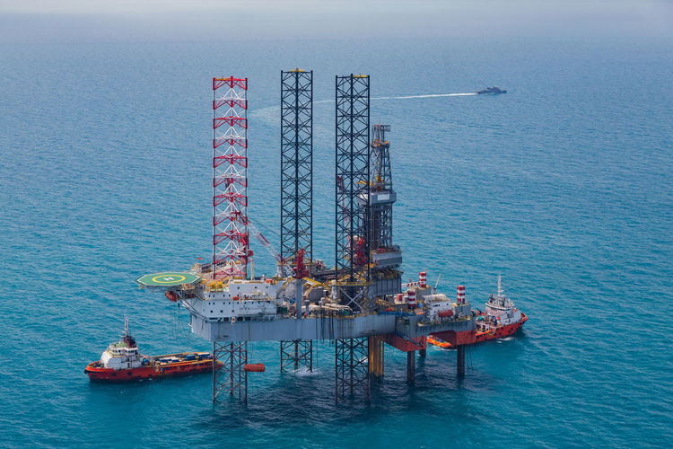 Oil rig in the gulf from aerial Boat Business Business Finance And Industry Day Drilling Rig Energy Environment Finance Fuel Gas Industry Machinery Nautical Vessel Offshore Offshore Platform Oil Oil Industry Oil Platform Outdoors Petroleum Power In Nature Rig Sea Sky Vessel