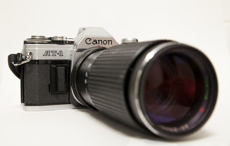 AT-1 Canon AT-1 Tokina Tokina Retro Camera Camera - Photographic Equipment Canon Close-up Digital Single-lens Reflex Camera Lens - Optical Instrument Old-fashioned Photographing Photography Themes Retro Styled Selective Focus Studio Shot Technology Vintage White Background