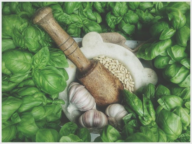 Pesto Genovese Sauce Recipe : Basilicum from Genova-Pra' or what you have ☺ BUT SMALL leaves (plant height 13 cm max.) - > = 50% Parmigiano Reggiano and < = 50% Pecorino Romano (sardo) - Pine nuts - garlic - salt. Add extravergine olive oil while working in the Mortar And Pestle or carefully (brief pulses) in the mixer. Experiment with ratios to get your best Pesto Alla Genovese DO NOT FORGET A LITTLE NUT OF BUTTER FOR EACH SERVING and keep the pasta (linguine trenette or cutted lasagne) not totally dried after cooking. a genoese is speaking . Green Color No People Day Full Frame Close-up Freshness Food /Italian Food Genova / Smartphone Photography Note 2 Traditional Food
