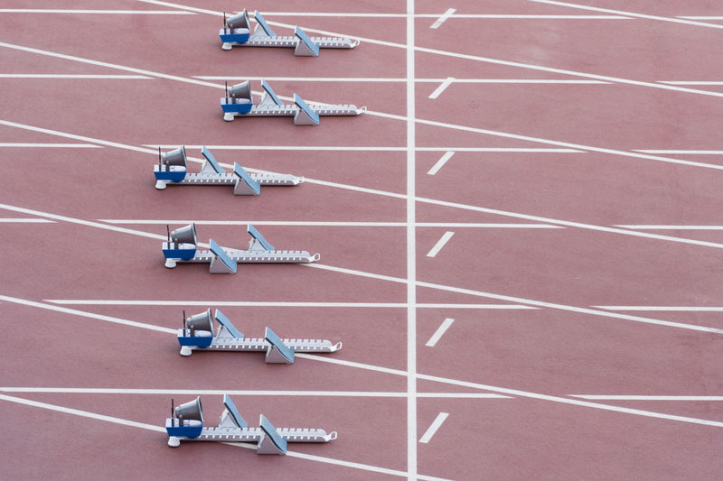High angle view of starting block on running track in stadium