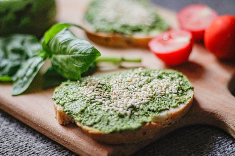 Close-up of bread with basil on cutting board