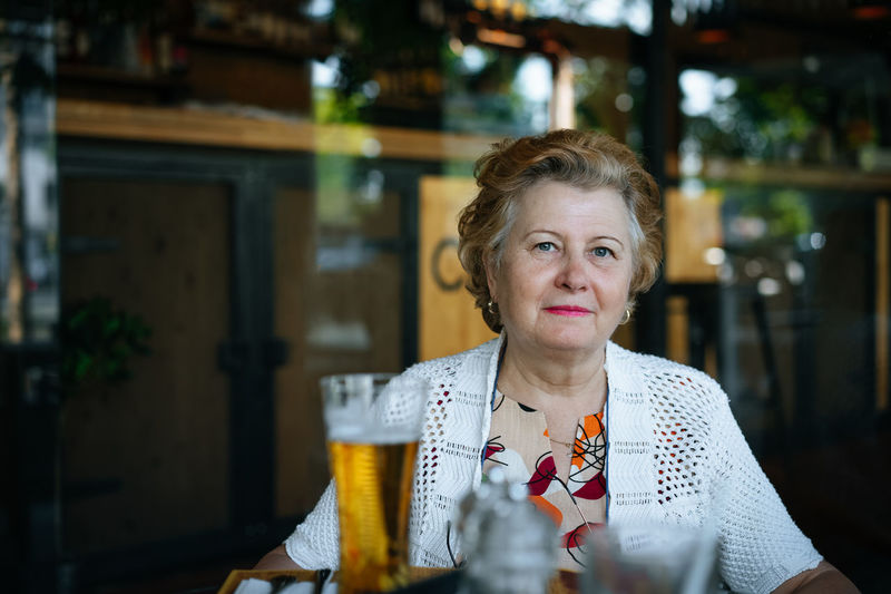 Portrait of senior woman sitting at restaurant