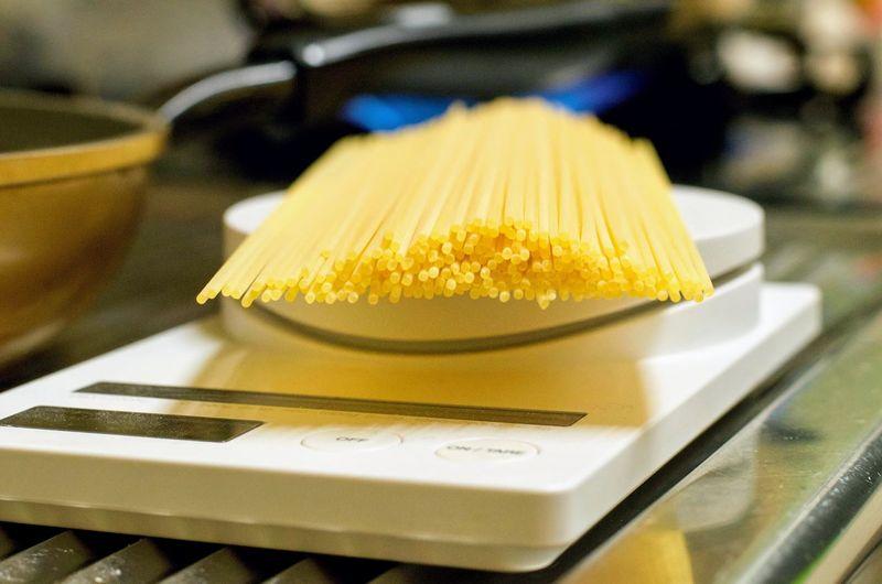 Weighing pasta.