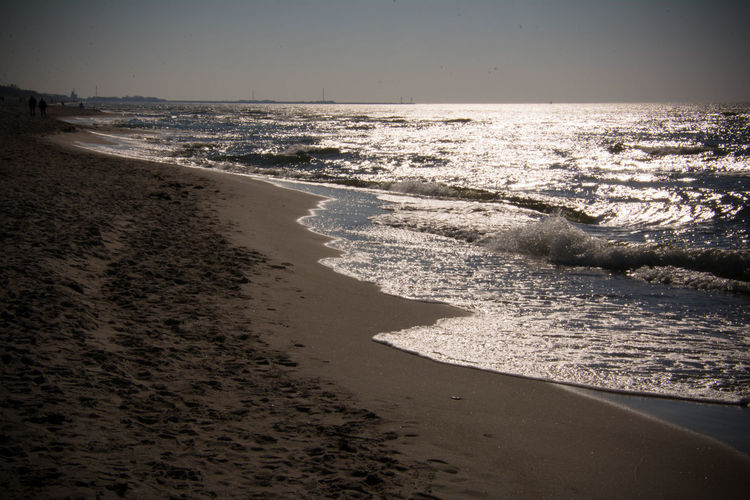 Sea Beach Water Land Horizon Horizon Over Water Sky Nature Beauty In Nature Sand Scenics - Nature Tranquility Motion Wave Day Outdoors Tranquil Scene Sunlight No People