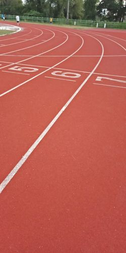 High angle view of numbers on empty running track