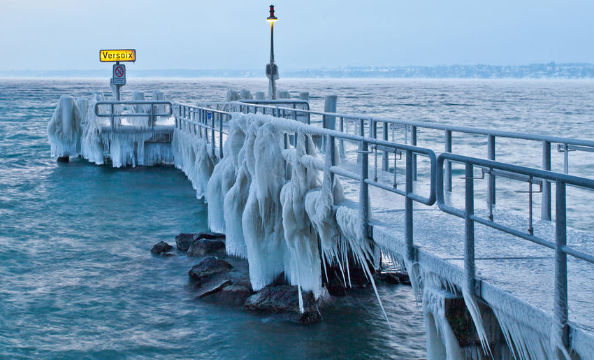 Jetty at calm sea during winter