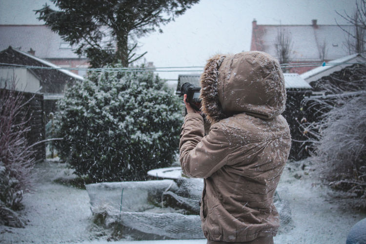 Frozen - lady Photographer taking snow photo in Snow fall Architecture Boys Building Exterior Built Structure Childhood Cold Temperature Day Leisure Activity Lifestyles Nature One Person Outdoors People Photography Themes Real People Rear View Snow Snowing Technology Tree Warm Clothing Weather Winter EyeEm Ready
