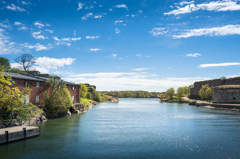 SUOMENLINNA, HELSINKI, FINLAND - MAY 26, 2017: Scenic summer view of Suomenlinna, Finland with sea and idyllic buildings at bright day Architecture Beauty In Nature Blue Sky Bright Building Exterior Built Structure Castle Defense History Island Landscape Nature Nature No People Outdoors Scenics Sky Summer Suomenlinna Tree War Water
